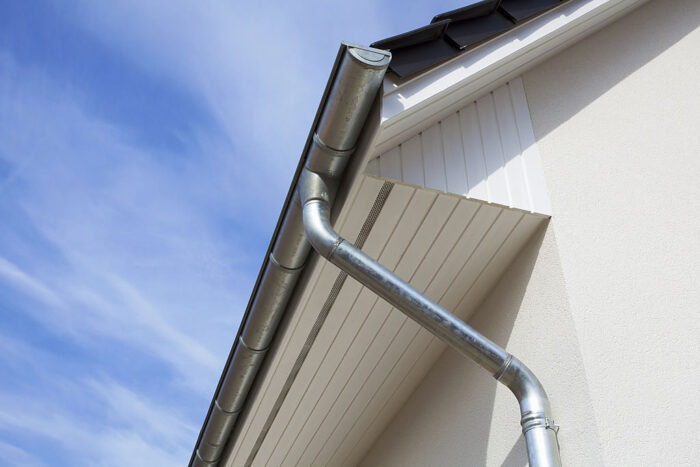 Rain gutter or Eavestrough with downspout maked of steel galvanized.